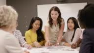 istock Teamwork during a marketing meeting 1166884737
