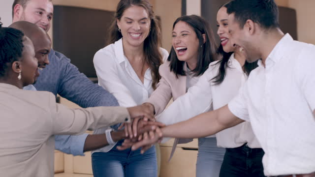 Teamwork is the fabric that binds a business together 4k video footage of a group of young businesspeople joining their hands in solidarity in a modern office heap stock videos & royalty-free footage