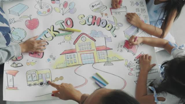 teamwork of drawing class - matita colorata video stock e b–roll