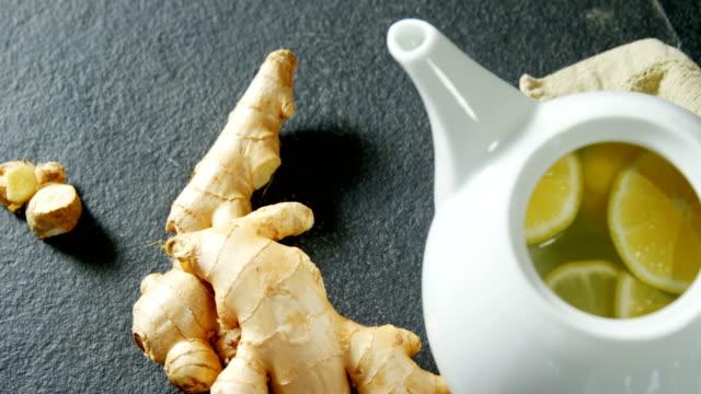 teapot with lemon and ginger 4k - teiera video stock e b–roll