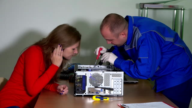 Technical engineer man explain curious customer woman computer problems