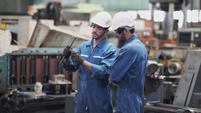 technical worker and mentor working with production line machine technical worker and mentor working with production line machine manufacturing equipment stock videos & royalty-free footage