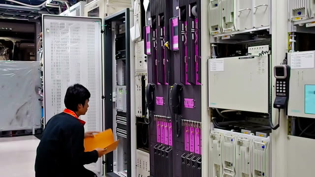 Technician checking network system Technician checking network system in network room mainframe stock videos & royalty-free footage