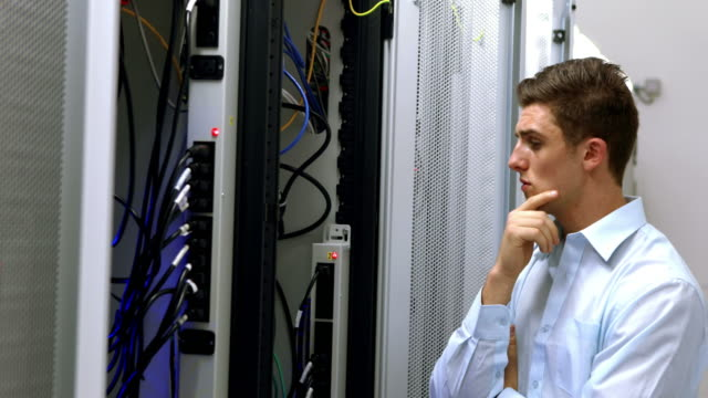 Technician looking at open server locker video