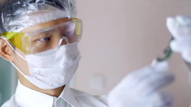 Technician QC microchip in the video