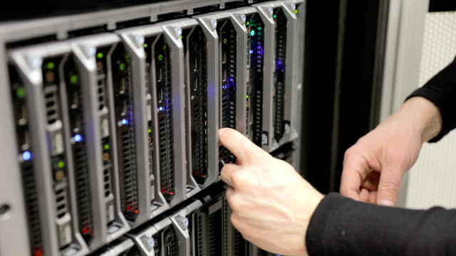 IT technician replace harddrive at blade server in datacenter video