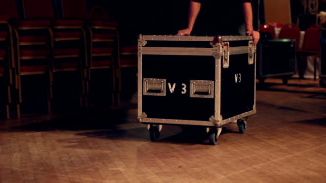 Technician / Roadie pushes a flightcase on stage video
