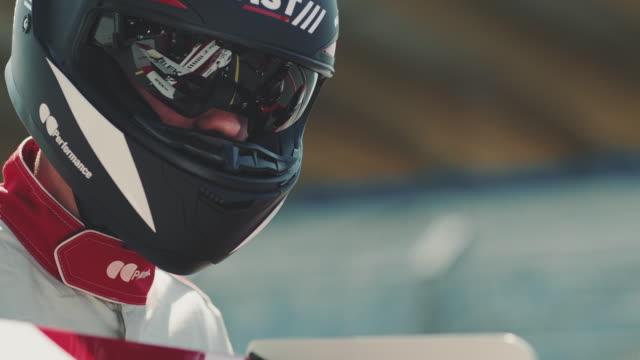 Technician wearing crash helmet during sports race