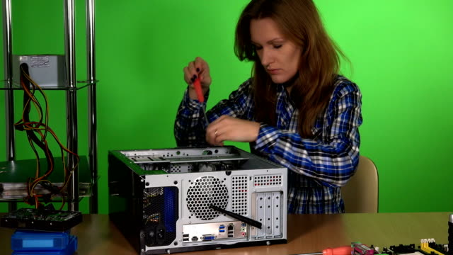 Technician woman take out pc hard drive and examine it