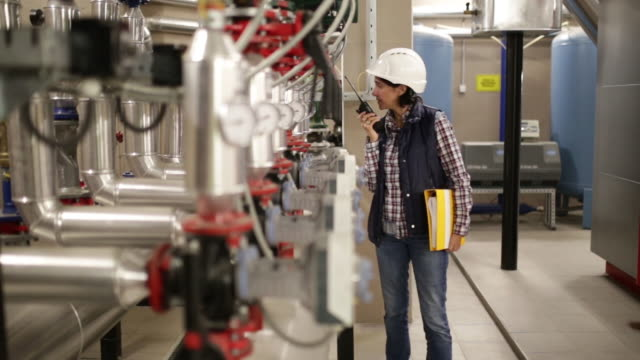 Technician working on valve in factory or utility