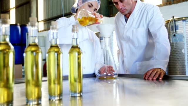 Technicians examining olive oil 4k video