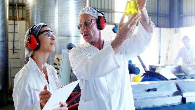 Technicians examining olive oil video