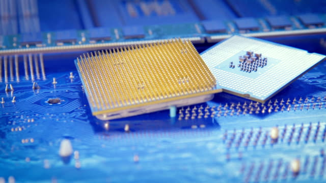 Technology background with computer processors CPU concept blue circuit board texture video