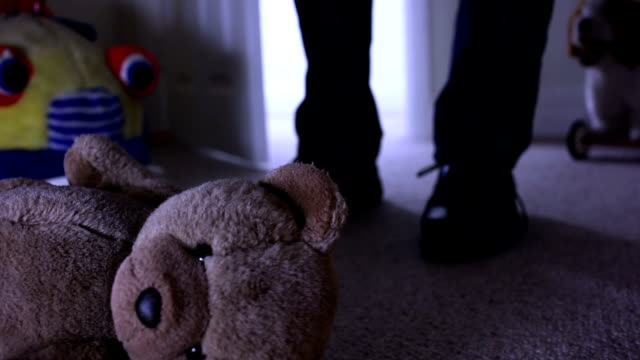 teddy bear, man leaving dark room. - child abuse stock videos & royalty-free footage