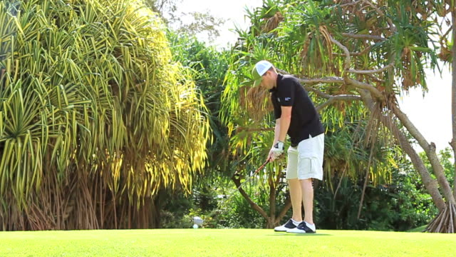 Teeing off Golf slow motion video