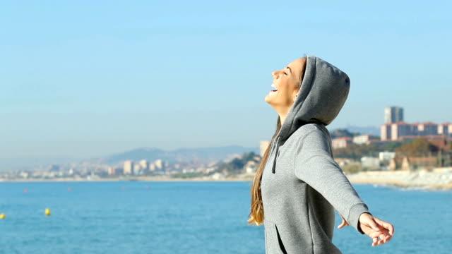 Teen breathing fresh air on the beach
