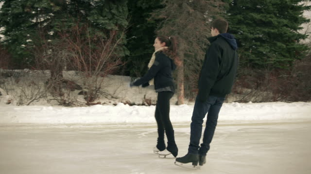 Teen couple on a skating date together. video