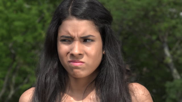 Teen Girl Covering Ears video