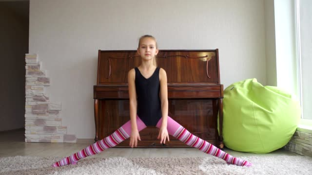 teen girl does some acrobatic [001] teen girl does some acrobatic activity doing the splits stock videos & royalty-free footage