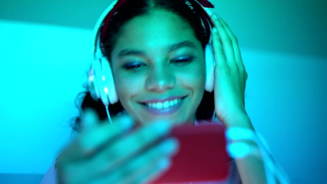Teen girl listening to MP3 player
