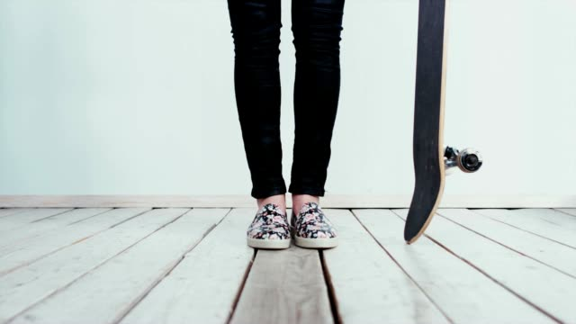 CINEMAGRAPH - Teen girl standing with a a skateboard video