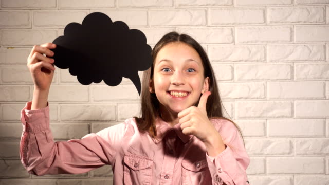 Teen girl with black thinking cloud Teen girl with black thinking cloud dreaming about something prop stock videos & royalty-free footage