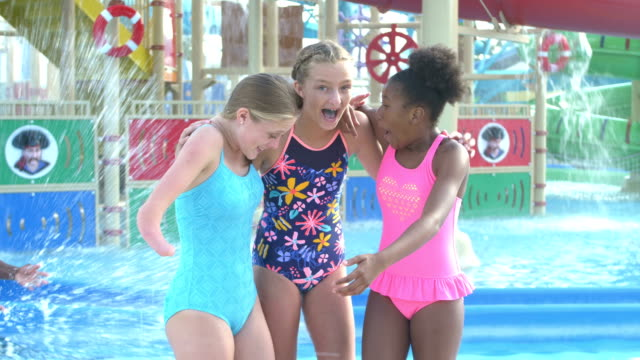 teen girl with malformed arm, friends at water park - предподростковый возраст стоковые видео и кадры b-roll