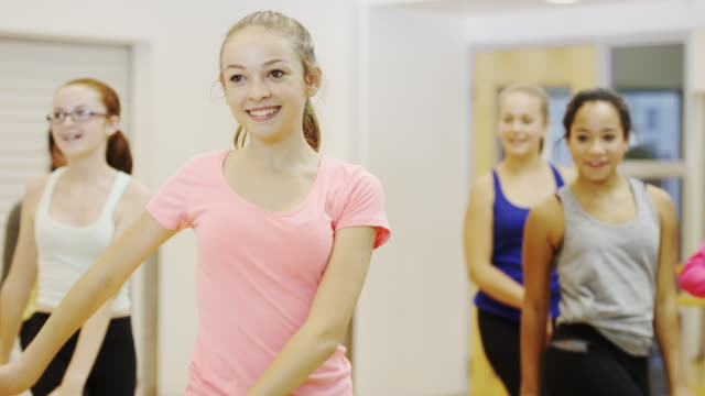 Teen girls at dance class practicing routine Teenage girls in a dance studio going over some dance moves. dance studio stock videos & royalty-free footage