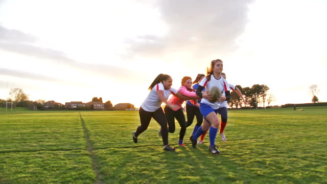 Teen Girls Playing Rugby on the Field A group of teen girls playing rugby on the field with their competitive friends! rugby stock videos & royalty-free footage