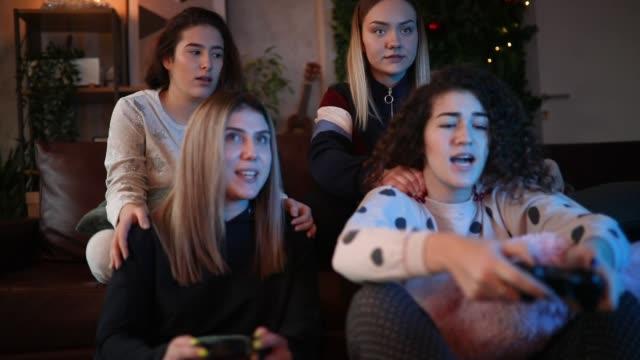 Teen girls playing video games