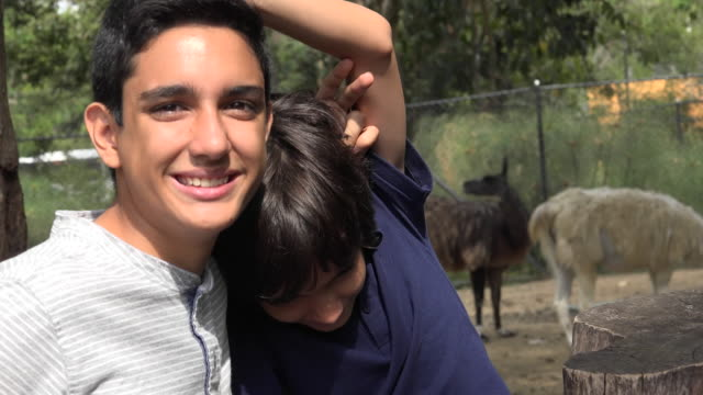 Teen Hispanic Brothers at the Zoo video
