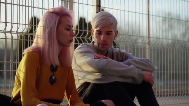 teenage boy consoling his worried friend - поколение z стоковые видео и кадры b-roll