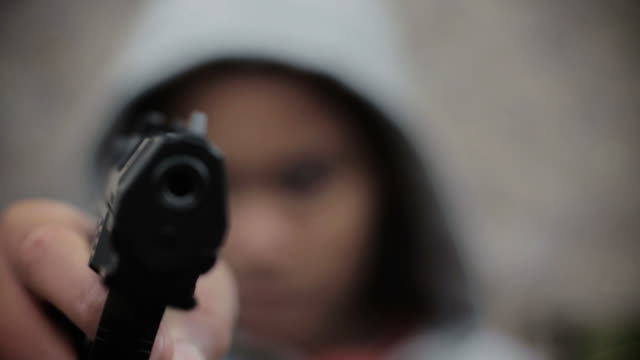 stockvideo's en b-roll-footage met dolly: teenage boy with gun - gun shooting