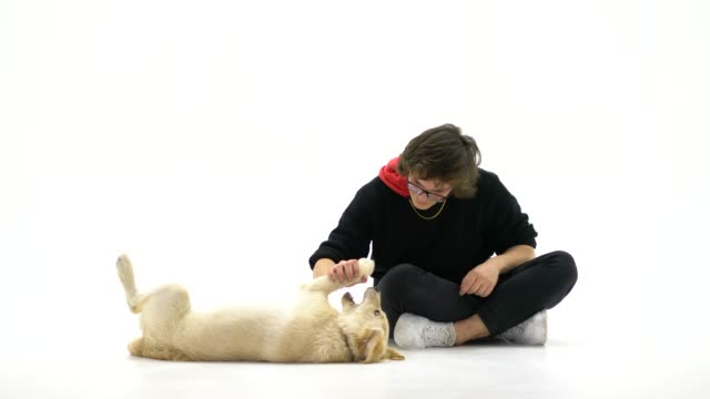 Teenage boy with her dog over white background