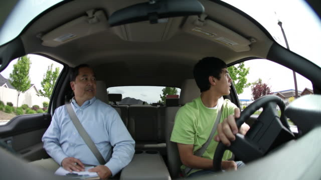 Teenage driver and driving instructor video