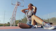 istock Teenage girl adjusting her headband on basketball court 1178793918