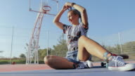 istock Teenage girl adjusting her headband on basketball court 1178794146