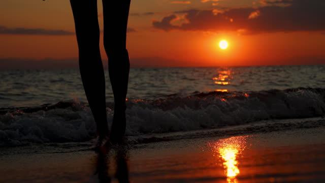 Teenage Girl alone at the beach enjoying beautiful sunset video