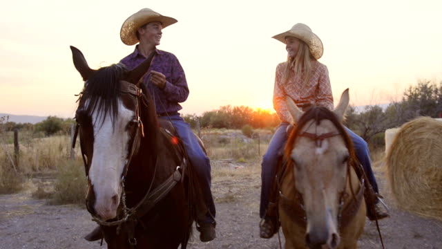 teenage girl and teenage boy riding horses - ranch video stock e b–roll