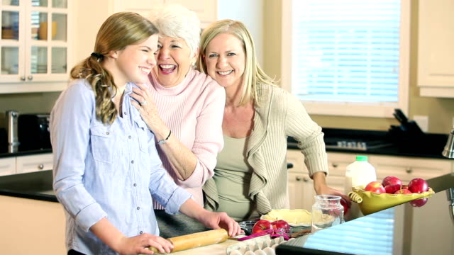 Teenage girl baking with mother and grandmother video