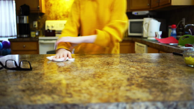 Teenage girl cleaning the kitchen counter video