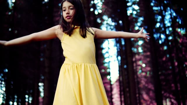 Teenage girl dancing in the forest