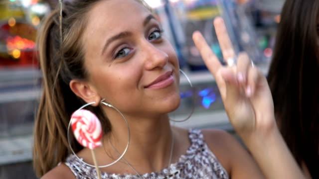 Teenage girl eats lollipop