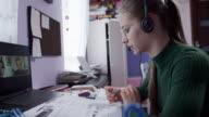 istock Teenage girl having online lesson in her room. 1219964164