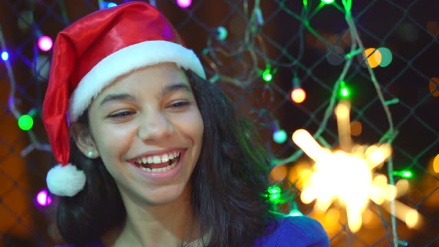 Teenage girl holding sparkler light in the Christmas night Brazil, Christmas, Lighting Equipment, Light - Natural Phenomenon, Illuminated natal stock videos & royalty-free footage