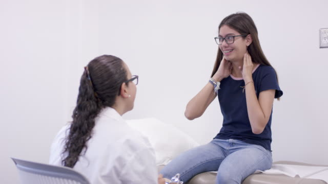 Teenage girl in medical appointment with female doctor