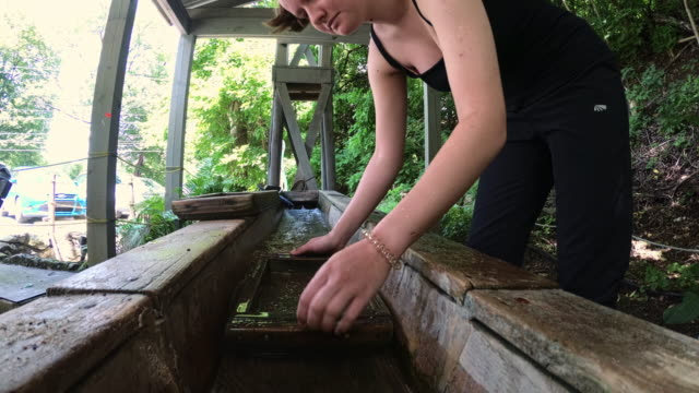 Teenage girl mining for minerals video