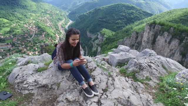 Teenage girl on the mountain top