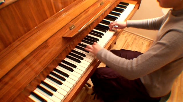 Teenage girl playing gamut on piano, scale up/down (HD 1080/50i) This is the original PAL format clip. musical theater stock videos & royalty-free footage