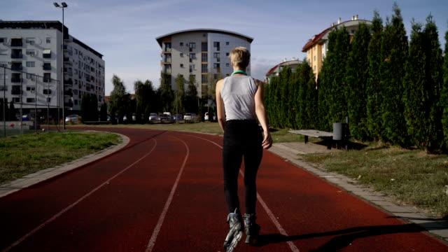 teenage girl rollerskating in park video